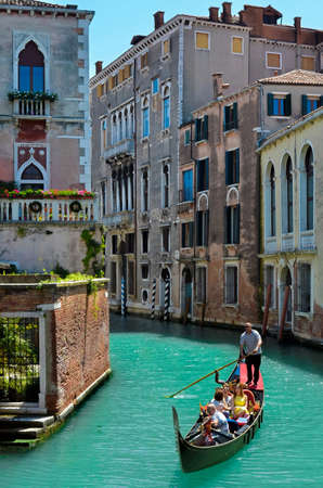 trip over: Venice (Italy) - 2016 may 22 - People enjoy a gondola trip over the canals in Venice