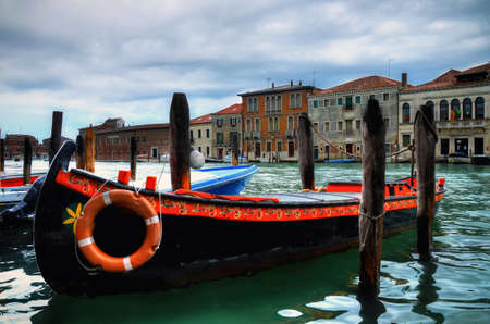 black moor: VENICE - MAY 23, 2016 - A painted boat docked in Murano on may 23, 2016. Murano is an island of the Venetian Lagoon