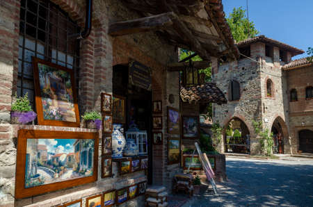 piacenza: PIACENZA, ITALY - AUGUST 14, 2016 - Historical houses and shops in Grazzano Visconti, neo-gothic village near Piacenza, Italy, on august 14, 2016.