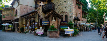 PIACENZA, ITALY - AUGUST 14, 2016 - Historical houses and shops in Grazzano Visconti, neo-gothic village near Piacenza, Italy, on august 14, 2016.