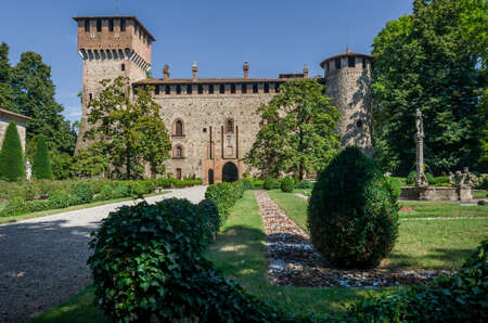 piacenza: PIACENZA, ITALY - AUGUST 14, 2016 - Medieval castle of Grazzano Visconti, near Piacenza, Italy, with neo-gothic renovations and italian gardens, on august 14,2016.