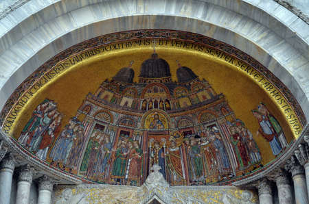 portals: Basilica di San Marco, in Venice. Detail of one of the portals, with a mosaic that represent the arrival of Saint Mark remains in the cathedral