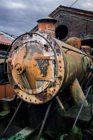 Rusty steam locomotive in the station of Turin Ponte Mosca (Italy), repair workshop for old trains