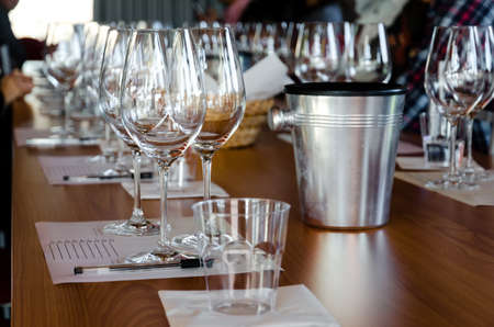 Table with glasses ready for wine tasting in a winery of Langhe (Italy) Stock Photo