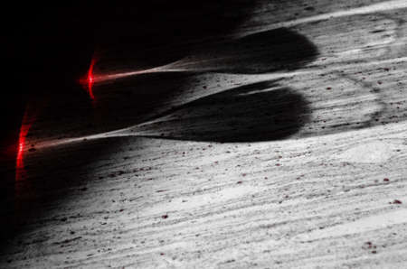 Shadows of two glasses of Nebbiolo wine hit by sunlight on a marble table Stock Photo