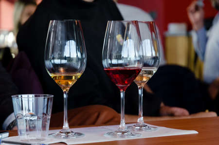 Wine tasting experience in Langhe (Italy) with three glasses of Moscato and Brachetto on a table