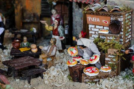 presepe: Pizza maker figurine in an handmade italian presepe (nativity scene) Stock Photo