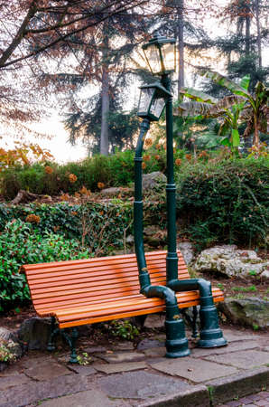 public figure: TURIN, ITALY - DECEMBER 11, 2016: Urban sculpture, made by Rodolfo Marasciuolo, of two street lamp in love sitting on a bench of Valentinos Park in Turin (Italy) on december 11, 2016 Editorial
