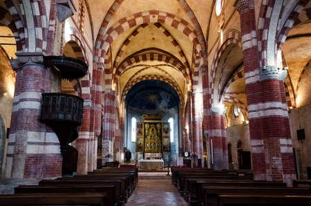 saluzzo: REVELLO, ITALY - JANUARY 22, 2017 – Central nave in the church of the Abbazia di Staffarda (Abbey of Staffarda) romanesque monastery in Revello (Italy) on january 22, 2017