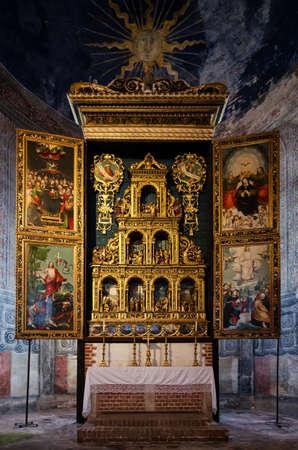 saluzzo: REVELLO, ITALY - JANUARY 22, 2017 – XVI century polyptych in the church of the Abbazia di Staffarda (Abbey of Staffarda) romanesque monastery in Revello (Italy) on january 22, 2017 Editorial