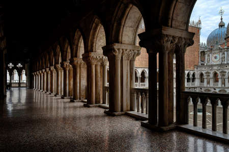ducale: VENICE, ITALY - MAY 24, 2016 - Colonnade and balcony in the courtyard of the Doges Palace (Palazzo Ducale) of Venice, Italy, on may 24, 2016