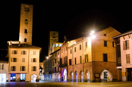 Piazza Risorgimento and the medieval towers of via Cavour, one of the main street of the town center of Alba (Piedmont, Italy) at night