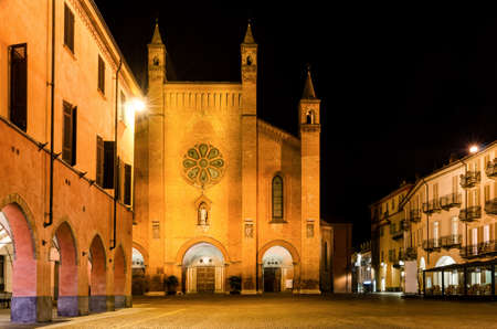 Piazza Risorgimento, main square of Alba (Piedmont, Italy) at night, with the facade of Saint Lawrence Cathedral Stock Photo