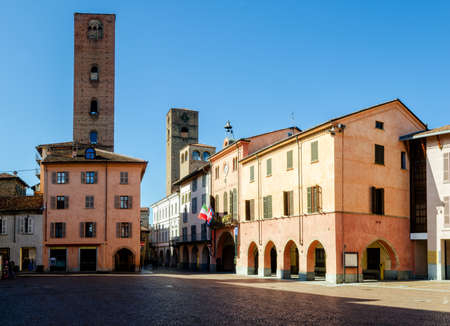 Piazza Risorgimento, main square of Alba (Piedmont, Italy) with Town Hall and medieval towers Stock Photo