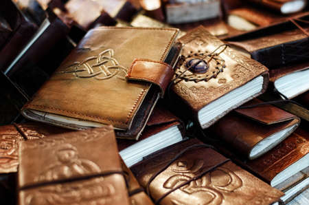many leather handcrafted diaries and notebooks with decorations Stock Photo