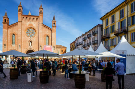 ALBA, ITALY - APRIL 22, 2017 - Tourists tasting traditional wines of Piedmont at Vinum, wine e food show event of Alba, piazza Risorgimento (Italy) on april 22, 2017 Editorial