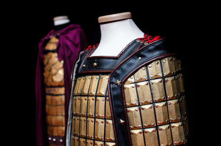 Mannequin wearing an oriental coat of plates, traditional medieval armor of east asian cultures Stock Photo