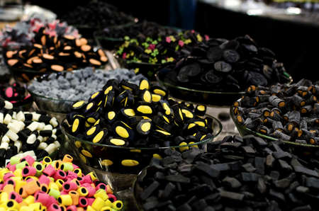 liquorice: many varieties of liquorice sweets candies on a market stall