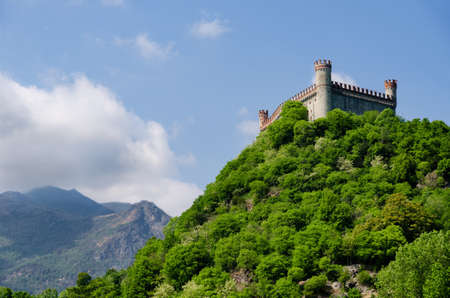 Castle of Montaldo Dora, in Canavese (Piedmont, Italy) with Alps on the background