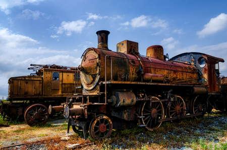 talian: Rusty old talian steam and electric locomotives  Stock Photo