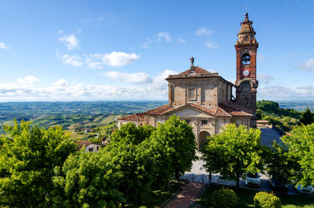 pictoresque: Main square of Diano dAlba (Piedmont, Italy), town in the hills of Langhe, with the gardens and the church of San Giovanni Stock Photo