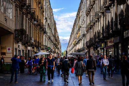 TURIN, ITALY - MAY 7, 2017: Via Garibaldi, main shopping street of Turin (Piedmont, Italy) crowded with tourists on a spring sunday, on may 7, 2017