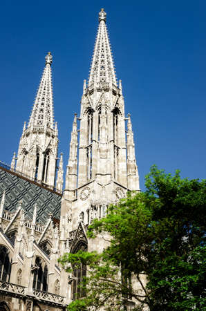 Bell towers and spires of the famous neo gothic Votivkirche (Votive Church) in Vienna, build by archduke Ferdinand Maximilian after the failed assassination attempt of his brother, Emperor Franz Joseph