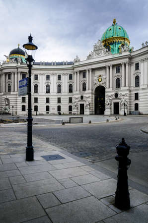 The Hofburg Palace in Vienna, ancient baroque imperial palace. Entrance of the Saint Michael wing in Michaelerplatz square