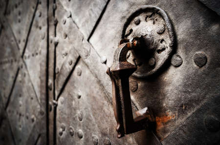 Antique iron knocker on a medieval castle door