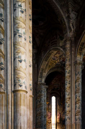 Cathedral of Asti, Italy. detail of the main nave with painted columns Editorial