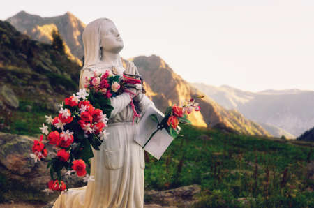 Votive Virgin Mary sculpture at Roccia dell'Apparizione (Rock of the Apparition) in the mountains of Vinadio: Piedmont, Italy; near the sanctuary of Sant'Anna (Saint Anne)