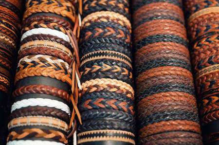 many leather handmade bracialets on a market stall Stock Photo