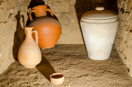 Ancient roman pottery in an antique tomb Stock Photo