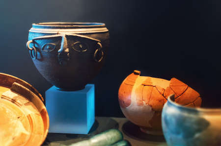 Ancient roman pottery and a face shaped vase Stock Photo