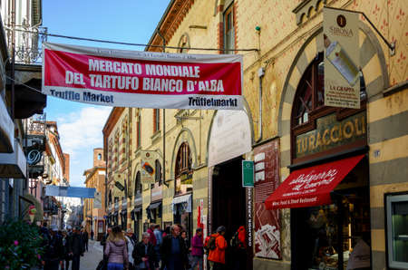ALBA, ITALY - NOVEMBER 15, 2018: People entering the truffle market of the International Truffle Fair of Alba (Piedmont, Italy), main truffle event in Italy, on November 15, 2018.