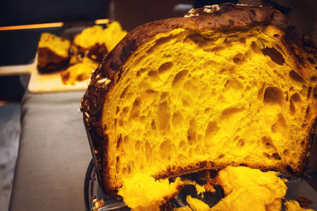 Panettone tasting event in italy, with the traditional italian christmas panetone sliced and ready to be eaten