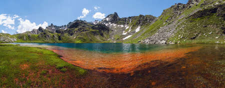 The Lac Bleu in Chianale, mountain lake in the italian alps of Cuneo, Piedmont. Reklamní fotografie