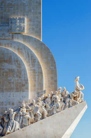 distant view of the padrao dos descobrimentos, monument to portuguese discoveries in lisbon, with clear blue sky and sunlight