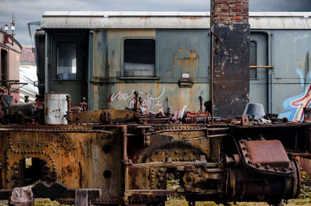 Rusty railcars in the station of Turin Ponte Mosca (Italy), repair workshop for old trains