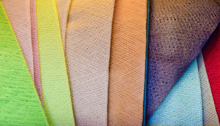 colorful texture detail of many handmade cotton thread fabric weaved lampshades stacked together
