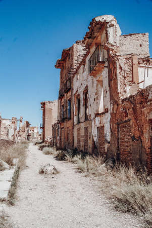 Destroyed houses on the main street of Belchite Stock Photo
