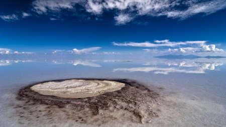 natural phenomena: underground spring penetrates through up to ten meters salt crust bringing mineral residuals to surface at salar de uyuni desert, bolivia Stock Photo