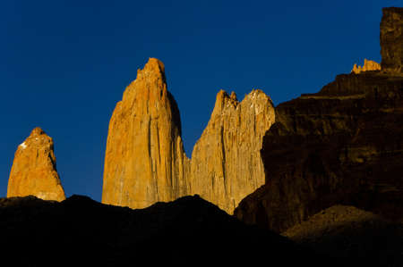 torres del paine: yellow torres del paine towers at sunrise, torres del paine national park, chile