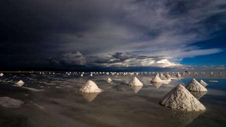uyuni: salt expoitation pyramids in salar de uyuni salt desert, bolivia, south america  Stock Photo