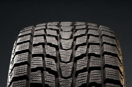 treads: studio close-up detail of black winter tire Stock Photo