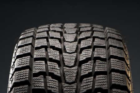 studio close-up detail of black winter tire Standard-Bild