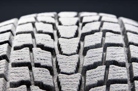 shorter: studio close-up detail of winter tire tread full of snow Stock Photo