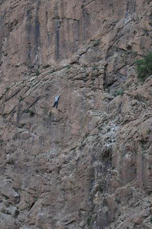 rockclimb: single person rockclimbing impressive mountain rock wall Stock Photo