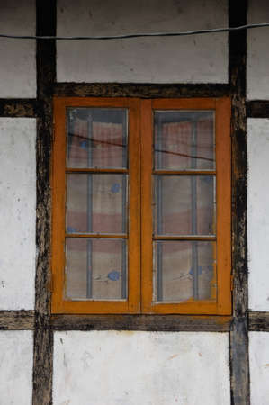 balk: orange latticed window with brown framework and white wall