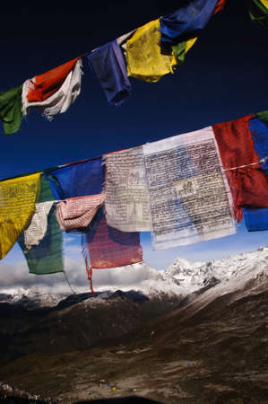 glacial: colorful prayer flags with himalaya mountain landscape